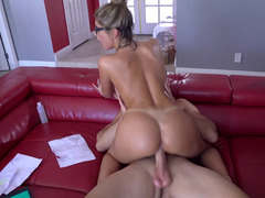 A blonde with glasses is on top of a man, riding his large pecker
