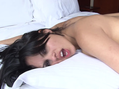 A skinny woman with a tight ass is naked on the bed in her room