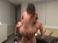 A big ass lovely lady is getting penetrated on the massage table