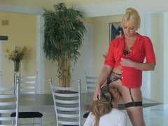A blonde is with her female friend, having intense lesbian sex