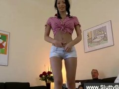 Cute cowgirl sucks the dick of an old man