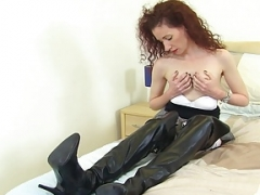 UK eager mom Scarlet pokes her fanny with a dildo