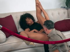 A chick with curly hair is getting her cunt penetrated deeply