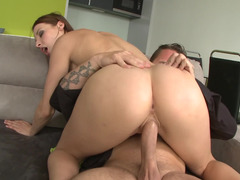 A brunette that has nice natural tits is riding a giant pecker
