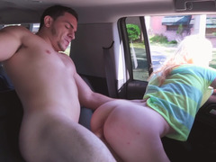 Blonde with a shaved cunt is in the back of a car, doing a large cock