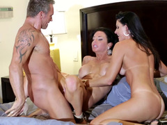 Two entrancing brunettes are able to bring man to the heaven