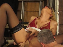 A blonde bimbo with glasses is with an old guy, receiving the cock