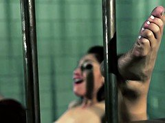 Jailed babes eat and finger pussy