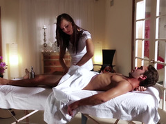 A woman shows off her flesh to the guy she is massaging