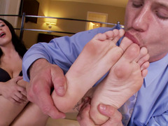 A brunette with sexy feet is getting her legs licked and her cunt banged
