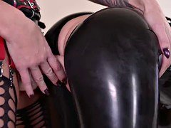 Strict housewife with big dick fucks her servant Latex Lucy