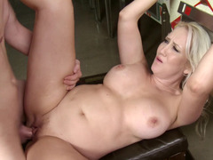 A busty plus sized blonde is sitting down on a big hard pecker