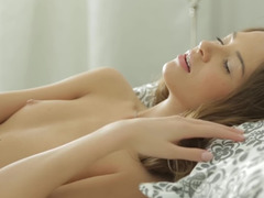 Kinky thing is presented with a rubber cock to suck on the bed
