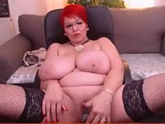A kinky fat granny with massive melons is teasing and masturbating on a webcam