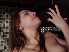 A brunette Latina is getting a dick in her snatch in the kitchen