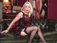Blonde excited granny is teasing in sexy lingerie is masturbating
