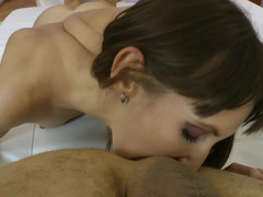 A sweet and all natural babe is on the white bed sheets, getting fucked