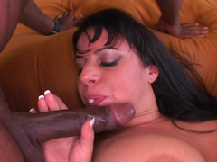 Two black dudes are doing some hard work on a milfs hot pussy