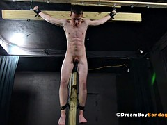 crucified blinking fucks herself with a dildo - BDSM bondage gay