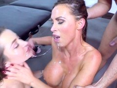Two chicks are doing two men in a hot foursome with a lot of oil