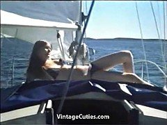 Young Couple Relaxing on the Yacht (1970s Vintage)