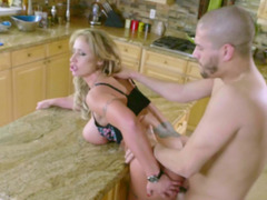 Milf slut and a horny stud fucking in her kitchen