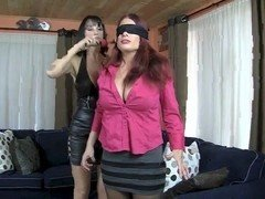 A busty milf gets blind folded and tied up so femdom slut can give her pleasure