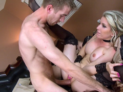 A blonde milf is getting her feet and her lovely pussy licked