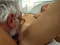 A busty blonde is getting some old dude's cum on her tits