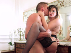 A blonde that is in her stockings is getting her pussy penetrated