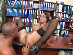 A bitch in stockings is getting fucked on the desk really hard