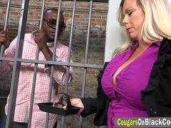 Brunette officer Amber Lynn Bach is seduced and fucked by a black prisoner