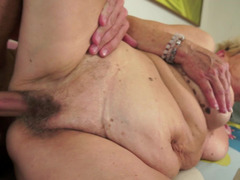 A fat granny is getting fucked and she is sucking a cock