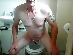 sissy ken attempts to wank in chastity