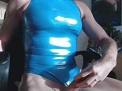 Crossdresser jerks off in his shiny Reasise swimsuit