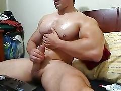 Hairles bodybuilder jerks off