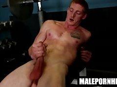 A hot muscular stud masturbates