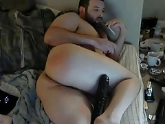 Beautiful bear enjoying a huge dildo