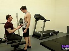 Tattooed hunk fucking this skinny dude in the ass at the gym