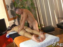 Oiled up guy gives his ass up to a masseur