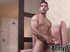 Horny soldier wanking his fat dark cock in hotel room