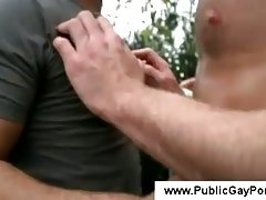 Tall white man kisses an arabic guy