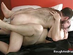Kinky gay scene with two dudes in leather sucking hard cock