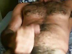 Hairy guy stroking