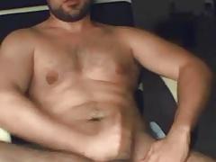 Muscular guy stroking hard
