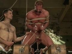 Gay skank Derek Pain gets tormented and fucked by two dominators
