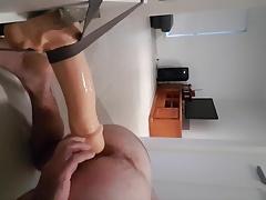 Hot young stud riding huge dildo