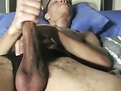 Slim Guy Jerking Off On A Bed
