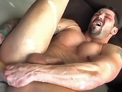 Muscle Lad Plays With A Dildo