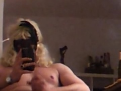 Travis new friend with a blonde wig and pantyhose